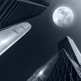Abstract futuristic cityscape at full moon night. Hong Kong Stock Photos