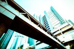 Abstract futuristic cityscape. Hong Kong. Abstract futuristic cityscape view with modern skyscrapers. Hong Kong. Tilt shift blur effect. Cross processing Stock Image