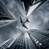 Abstract futuristic cityscape view with airplane. Hong Kong Stock Photos