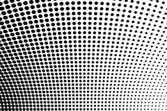 Abstract futuristic halftone pattern. Comic background. Dotted backdrop with circles, dots, point large scale. Black, white color Royalty Free Stock Image