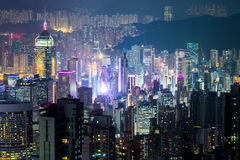 Abstract futuristic night cityscape. Hong Kong aerial view Royalty Free Stock Image
