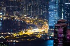 Abstract futuristic night cityscape. Hong Kong Stock Photos