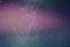 Abstract galaxy background with stars and planets with pink galaxy space universe night light motif