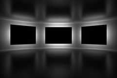 Abstract gallery interior. Three blank frames with a backlight Stock Photos