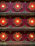 Abstract geometric background of oriental thai red ceiling architectural pattern. Abstract geometric background of oriental thai red and gold ceiling royalty free stock photo