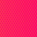 An abstract geometric background or pattern that is made up of hexagons of different sizes. Modern texture in pink and orange Royalty Free Stock Photos