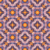 Abstract geometric background - seamless vector pattern in orange, violet, and lilac colors. Ethnic boho style. Mosaic ornament. Stock Images