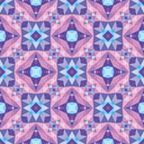 Abstract geometric background - seamless vector pattern in violet, lilac and blue colors. Ethnic boho style. Mosaic ornament. Stock Images