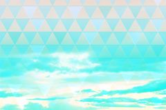 Abstract, geometric background with triangles and clouds royalty free stock photos