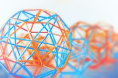 Abstract Geometric Blurred Background. Coloured three-dimensional model of geometric solids closeup defocused - abstract blurred background Royalty Free Stock Photo