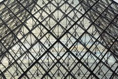 Abstract detail of the glass and steel pyramid of the Louvre museum Paris, France stock image