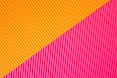 Abstract geometric paper background in vibrant orange and pink trendy colors royalty free stock photos