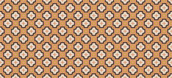 Abstract geometric pattern. Cloth design, wallpaper. Geometric pattern of the knitted fabric of orange, blue and white Royalty Free Stock Photography