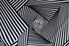 Abstract geometric pattern on fabric. From above Stock Photo