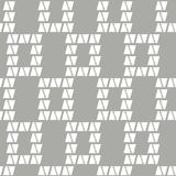 Abstract geometric plaid seamless vector pattern of triangle with jagged edge and wavy lines on grey background. Abstract geometric plaid seamless vector pattern Stock Photography