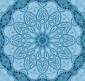 Seamless round floral ornament in blue shades centered stock illustration
