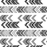 Abstract geometric seamless hand drawn pattern with tribal motifs. Modern texture. Monochrome free hand background. Stock Images