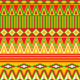 Abstract geometric seamless pattern in tribal style. Bright abstract geometric seamless pattern in tribal style in warm colors Royalty Free Stock Photos