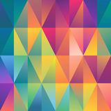 Abstract geometric spectrum pattern background. Christmas festive gift wrapping paper design with abstract triangle multicolor spectrum geometric pattern Royalty Free Stock Photography