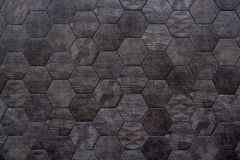 Abstract geometric wall texture. Modern pattern of stone wall decorative surfaces. Texture background. Hexagonal tiles. Wall texture of the decorated stone tiles Royalty Free Stock Photography