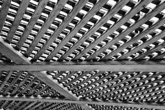 A black and white geometrical pattern of tiny repetitive details stock photos