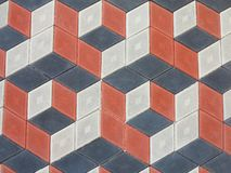 Abstract geometrical brick stone pavement black and red pattern Royalty Free Stock Image