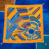 Abstract geometrical pattern on silk. Batik stock photos