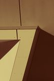 Abstract Geometrical Patterns. Close up of parts of a modern building and shadows, creating geometrical designs.   Image in sepia tones Stock Images