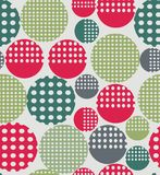 Abstract geometry from circles with holes. In green, purple, gray. A seamless pattern on a light gray background Stock Image