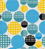 Abstract geometry from circles with holes. In yellow, pink, blue, black. A seamless pattern on a light gray background Stock Images