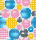 Abstract geometry from circles with holes. Yellow, pink, blue. A seamless pattern on a light gray background Royalty Free Stock Image