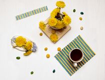 Abstract geometry composition with cup. Of coffee, candy and dandelions stock photo