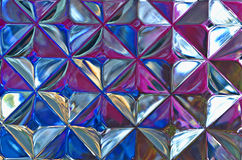 Abstract Of Glass Block W/Varied Colors. Image of glass block with several colors placed near it to give the facets an almost diamond like quality Stock Photography