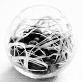 Abstract glass bowl. A black and white image of a glass bowl filled with nuts stock image