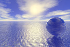 Abstract glass globe over blue ocean Royalty Free Stock Photography