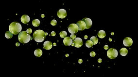 Abstract Glass Spheres. Abstract futuristic green balls hanging in space over a black background Royalty Free Stock Photo