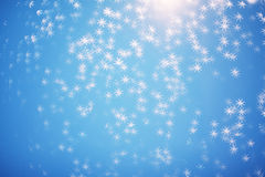 Abstract glitter festive christmas texture with shining stars o. N blue background, defocused Royalty Free Stock Images