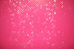 Abstract glitter festive christmas texture with shining stars o. N pink background, defocused Stock Image