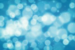 Abstract glitter bokeh on black background stock photography