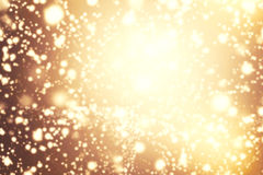 Abstract Glitter vintage lights background. Gold, brown, red a Royalty Free Stock Photo