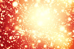 Abstract Glitter vintage lights background. Gold, brown, red a Stock Images