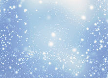 Abstract glittering stars on bokeh background.   Festive blue an Royalty Free Stock Images