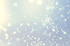 Abstract glittering stars over blue bokeh background.   Festive Royalty Free Stock Photos