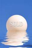 Abstract globe concept on the water. With the word sold Royalty Free Stock Photography