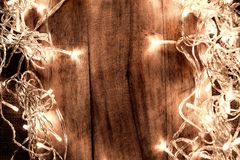 Abstract Glowing Christmas Lights in wreath shape, greeting card Stock Photo