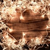 Abstract Glowing Christmas Lights in wreath shape, greeting card Royalty Free Stock Photo