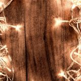 Abstract Glowing Christmas Lights in wreath shape, greeting card Stock Image