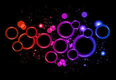 Abstract Glowing Circles of light with rainbow colors background. Royalty Free Stock Photos