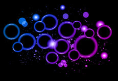Abstract Glowing Circles of light with rainbow colors background. Stock Images