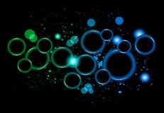 Abstract Glowing Circles of light with rainbow colors background. Royalty Free Stock Image